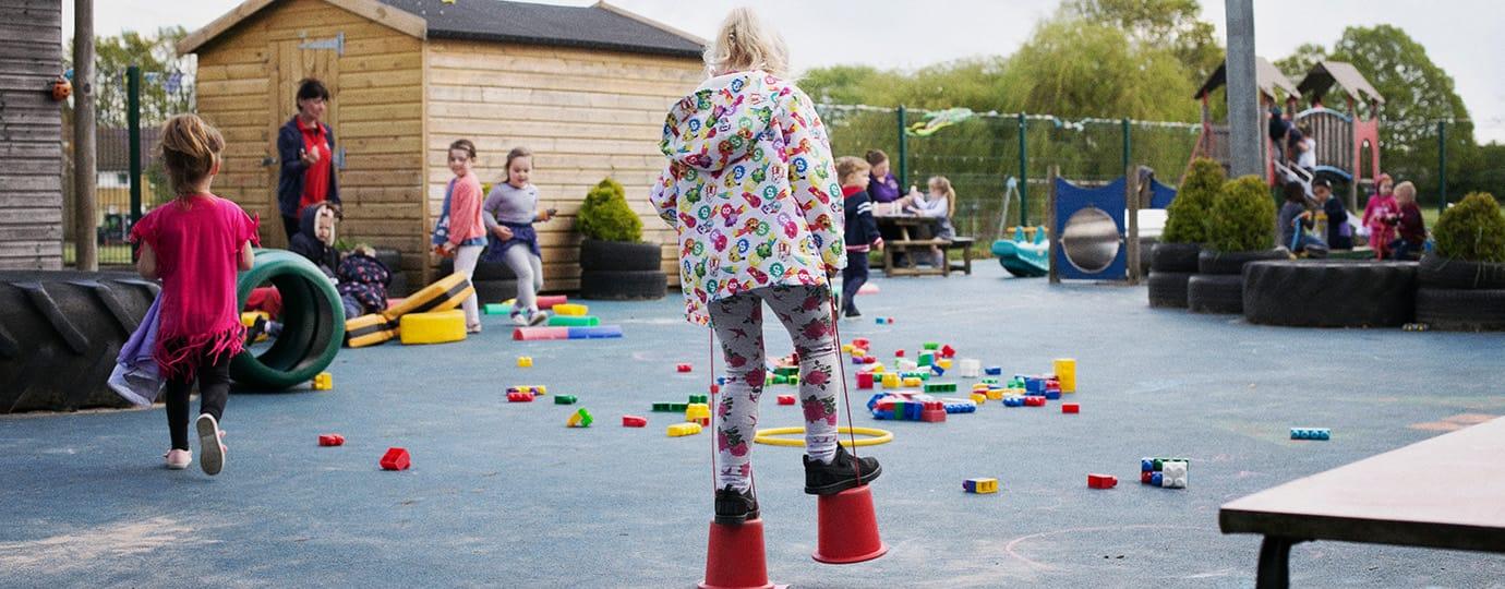 Making stilts in playground